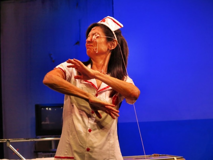 Robin Brenner (Nurse) gets blood in her face. Photo by Jonathan Slaff.